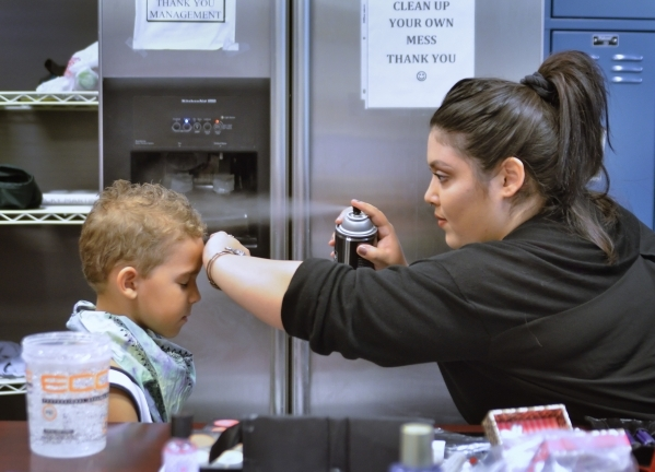 Makeup artist and hair stylist Nichole Champion works on Kane Ellis at the Opportunity Village Thrift Store at 390 S. Decatur Blvd. in Las Vegas on Sunday, Oct. 4, 2015. Bill Hughes/Las Vegas Revi ...