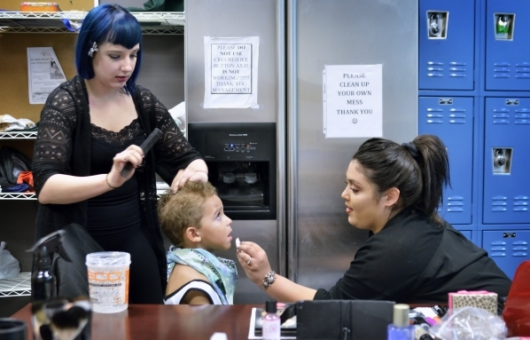 Makeup artists and hair stylists Briana Agnello (cq), left, and Nichole Champion, right, work on Kane Ellis at the Opportunity Village Thrift Store at 390 S. Decatur Blvd. in Las Vegas on Sunday,  ...