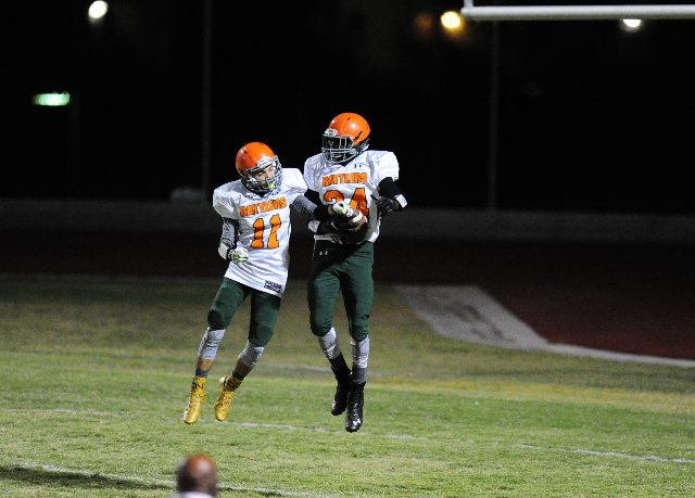 Mojave wide receivers Jaylon Delgado (11) and Jesse James celebrate a touchdown against Spring Valley in the first quarter of their prep football game at Spring Valley High School in Las Vegas Fri ...
