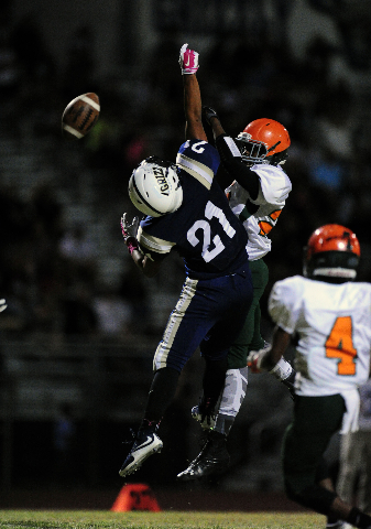 Mojave Rattlers safety Jesse James, right, breaks up a pass intended for Spring Valley Grizzlies wide receiver Julio Rosas Sanchez (21) in the fourth quarter of their prep football game at Spring  ...