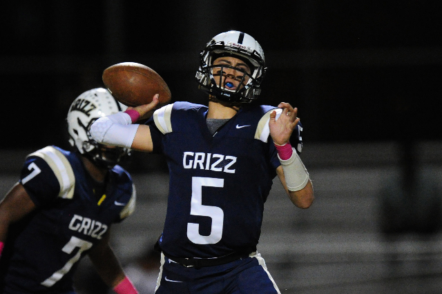 Spring Valley Grizzlies quarterback K.C. Moore (5) passes against Mojave in the third quarter of their prep football game at Spring Valley High School in Las Vegas Friday, Oct. 2, 2015. Mojave def ...