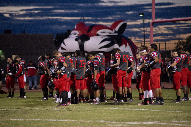 The Las Vegas High School football team takes a minute of silence for alumni who passed away recently during their prep football game at Las Vegas High School on Friday, Oct. 2, 2015. Daniel Clark ...