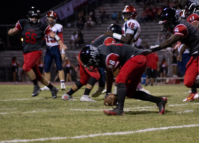 Las Vegas' Josh Perez (26) picks up a Coronado fumble during their prep football game at Las Vegas High School on Friday, Oct. 2, 2015. Daniel Clark/Las Vegas Review-Journal