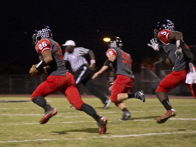 ]Las Vegas' Josh Perez (26) returns a Coronado fumble for a touchdown during their prep football game at Las Vegas High School on Friday, Oct. 2, 2015. Daniel Clark/Las Vegas Review-Journal