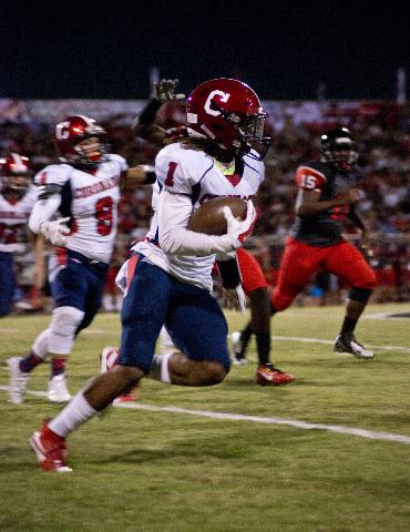 Coronado's DaQu'an Davis (1) runs the ball upfield during their prep football game at Las Vegas High School on Friday, Oct. 2, 2015. Daniel Clark/Las Vegas Review-Journal