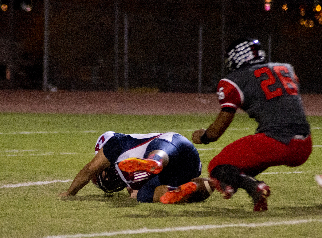 Coronado's Adolfo Sandoval (77) attempts to recover a high snap as Las Vegas' Josh Perez (26) does the same during their prep football game at Las Vegas High School on Friday, Oct. 2,  ...