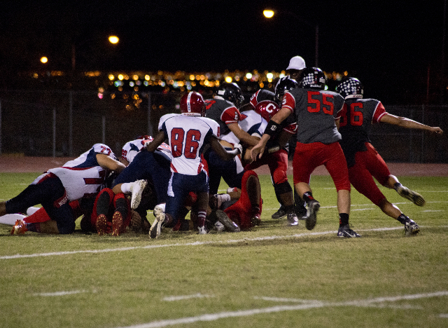 Las Vegas recovers a ball fumbled by Coronado during their prep football game at Las Vegas High School on Friday, Oct. 2, 2015. Daniel Clark/Las Vegas Review-Journal