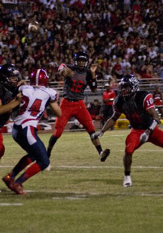 Las Vegas High School quarterback Zach Matlock (12) passes the ball for a touchdown during their prep football game at Las Vegas High School on Friday, Oct. 2, 2015. Daniel Clark/Las Vegas Review- ...