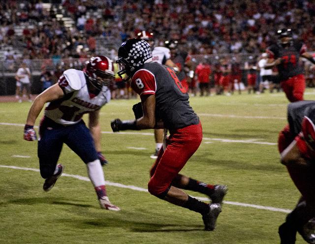 Las Vegas' Hanoi Rabago (8) runs the ball in for a touchdown during their prep football game at Las Vegas High School on Friday, Oct. 2, 2015. Daniel Clark/Las Vegas Review-Journal