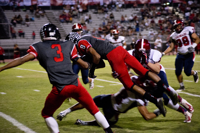 Las Vegas' Hanoi Rabago (8) dives for a touchdown during their prep football game at Las Vegas High School on Friday, Oct. 2, 2015. Daniel Clark/Las Vegas Review-Journal