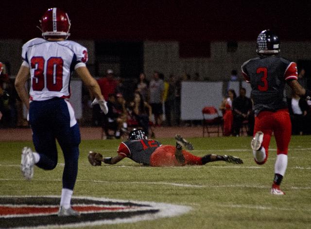 Las Vegas High School quarterback Zach Matlock (12) recovers a fumbled snap during their prep football game at Las Vegas High School on Friday, Oct. 2, 2015. Daniel Clark/Las Vegas Review-Journal