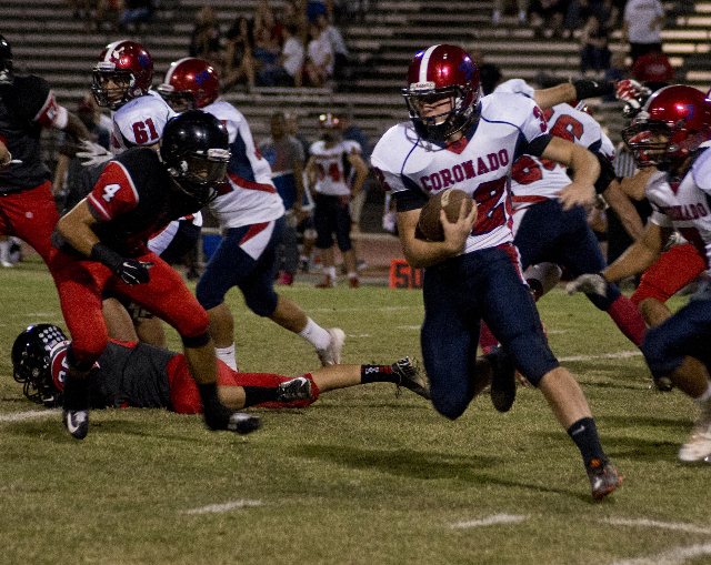 Coronado's Walker Wright (32) attempts to move the ball upfield during their prep football game at Las Vegas High School on Friday, Oct. 2, 2015. Daniel Clark/Las Vegas Review-Journal