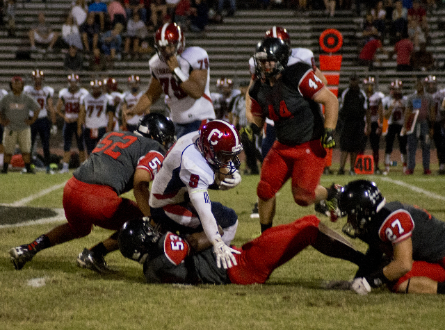 Coronado's Andrew St. Clair (8) is tackled during the prep football game at Las Vegas High School on Friday, Oct. 2, 2015. Daniel Clark/Las Vegas Review-Journal