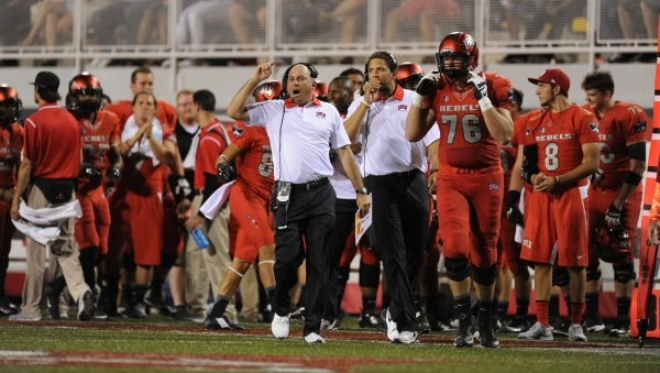 UNLV Rebels head coach Tony Sanchez motions to his players in the first of their NCAA Football game against Idaho State at Sam Boyd Stadium in Henderson Saturday, Sept. 26, 2015. UNLV defeated Ida ...