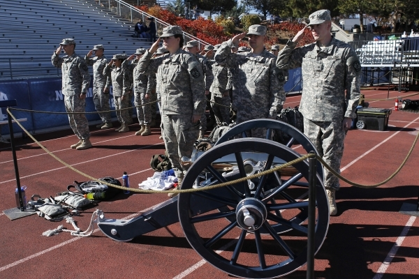 Members of the University of Nevada Reno's ROTC stand at attention while guarding the Fremont Cannon trophy before the start of the big rivalry football game between UNLV and UNR in Reno on  ...