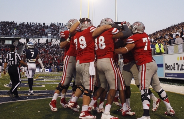 UNLV players gather in the end zone to celebrate a second half touchdown against UNR at Mackay Stadium in Reno on Oct. 26, 2013. (Jason Bean/Las Vegas Review-Journal)