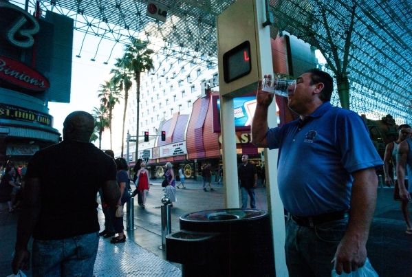 A man drinks a beer at the Fremont Street Experience in downtown Las Vegas on Thursday, Oct. 1, 2015. Chase Stevens/Las Vegas Review-Journal Follow @csstevensphoto