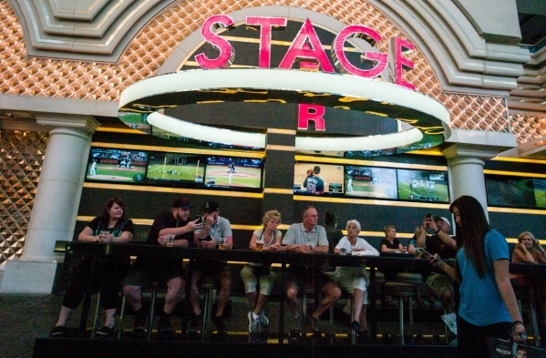 People relax with drinks at a bar at the Fremont Street Experience in downtown Las Vegas on Thursday, Oct. 1, 2015. Chase Stevens/Las Vegas Review-Journal Follow @csstevensphoto