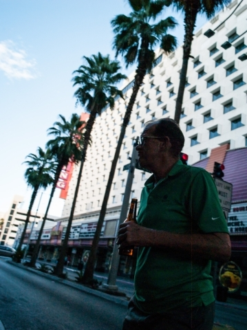 A man with a beer crosses Casino Center Boulevard at Fremont Street in downtown Las Vegas on Thursday, Oct. 1, 2015. Chase Stevens/Las Vegas Review-Journal Follow @csstevensphoto