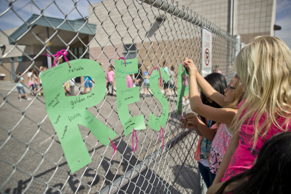 Students hang letters spelling out the word 'respect' on the gates around their school during the Week of Respect at Aldeane Comito Ries Elementary School on Wednesday, Sept. 30, 2015. ...