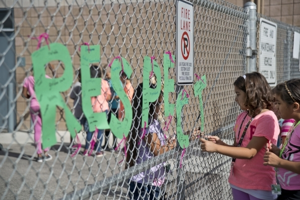 Students hang letters spelling out the word 'respect' on the fence around their school during the Week of Respect at Aldeane Comito Ries Elementary School on Wednesday, Sept. 30, 2015. ...