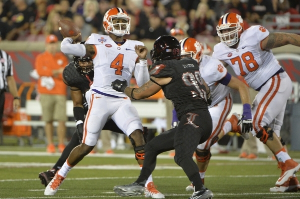 Sep 17, 2015; Louisville, KY, USA; Clemson Tigers quarterback Deshaun Watson (4) looks to throw against the Louisville Cardinals during the second quarter at Papa John's Cardinal Stadium. Ma ...