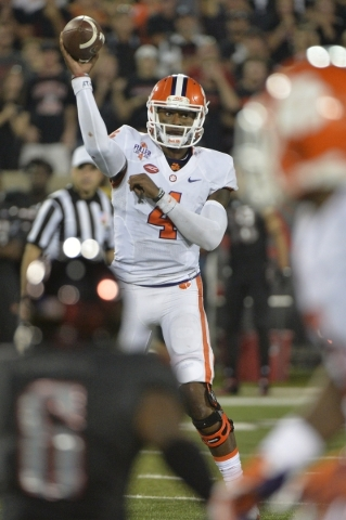 Sep 17, 2015; Louisville, KY, USA; Clemson Tigers quarterback Deshaun Watson (4) throws a pass against the Louisville Cardinals during the second half at Papa John's Cardinal Stadium. Clemso ...
