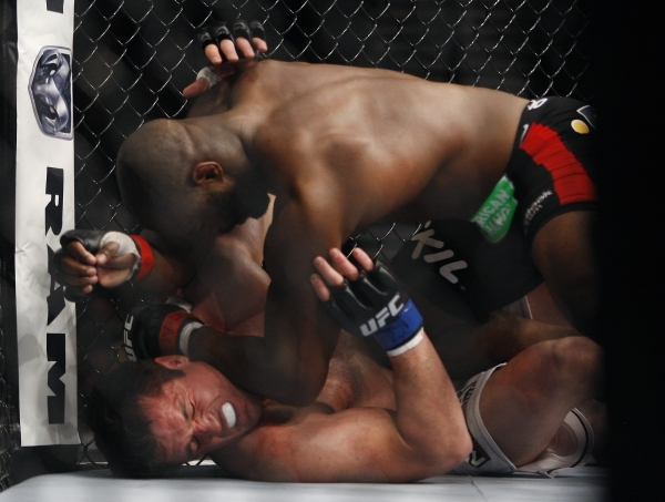 Rashad Evans, top, pounds on Chael Sonnen during UFC 167 at the MGM Grand Garden Arena in Las Vegas on Nov. 16, 2013. (Jason Bean /Las Vegas Review-Journal)