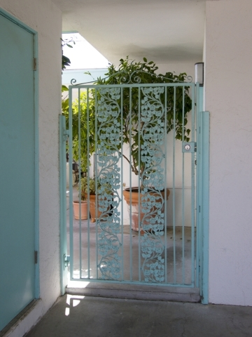 A wrought-iron gate leads to the patio of John Delikanakis and German Delgado's 1959 ranch home in Beverly Green. The couple is supporting a drive to get the neighborhood recognized by the c ...