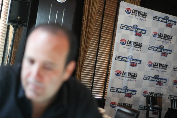 Juan Carlos Martinez, president of Rhino Linings, the title sponsor for the Rhino Linings 350 NASCAR truck race, speaks during an interview before a press conference before the race in Las Vegas o ...