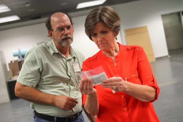 Las Vegas Natural History Museum Director Marilyn Gillespie, right, and facility manager Glenn Orsburn, left, look at a note from one of the hundreds of boxes of artifacts loaned to the museum by  ...
