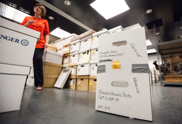 One of the hundreds of boxes of artifacts loaned to the Las Vegas Natural History Museum by the Bureau of Land Management is shown at the museum's collections and research facility in Las Ve ...