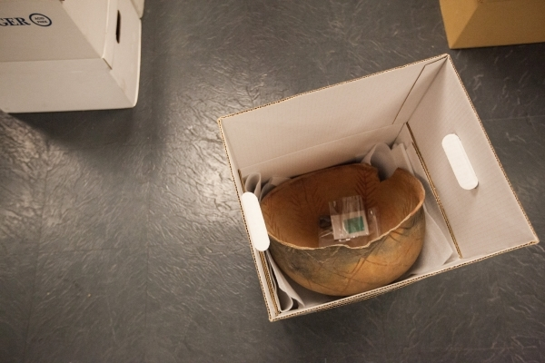A pot is shown inside one of the hundreds of boxes of artifacts loaned to the Las Vegas Natural History Museum by the Bureau of Land Management, at the museum's collections and research faci ...