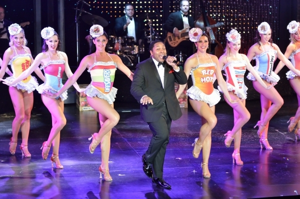 Darren Lorenzo, center, performs with cast members from ìVegas! the Showî at the Saxe Theater in the Miracle Mile Shops at the Planet Hollywood hotel-casino at 3667 Las Vegas Blvd. South in  ...