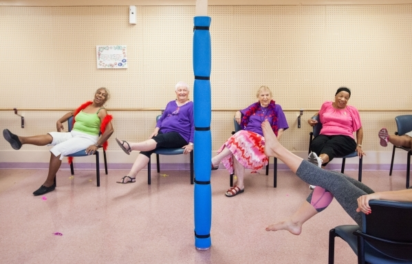 Seventy-nine-year-old Betty Cleveland, from left, Judy England, 73, Paulisca Buckholz, 84, and Dee Gordon, 81, participate in a burlesque dance class at Derfelt Senior Center in Lorenzi Park in La ...