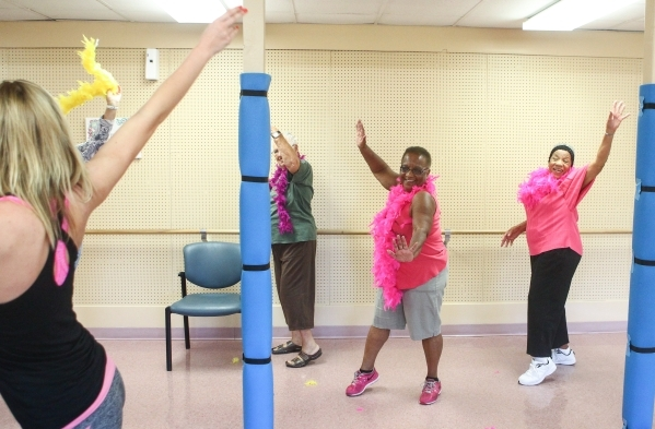Sara Hoffman, left, leads a burlesque dance class as, from left, Patty Jacobs, 80, Sally Phillips, 74, and Dee Gordon, 81, participate at Derfelt Senior Center in Lorenzi Park in Las Vegas on Thur ...