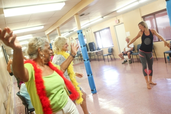 Sara Hoffman, right, leads a burlesque dance class at Derfelt Senior Center in Lorenzi Park in Las Vegas on Thursday, Oct. 1, 2015. It was the first time the class was being held. Chase Stevens/La ...