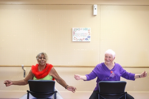 Seventy-nine-year-old Betty Cleveland, left, and Judy England, 73, participate in a burlesque dance class at Derfelt Senior Center in Lorenzi Park in Las Vegas on Thursday, Oct. 1, 2015. It was th ...