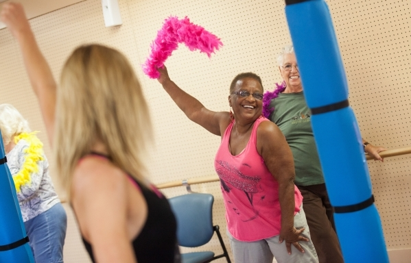 Sally Phillips, 74, participates in a burlesque dance class at Derfelt Senior Center in Lorenzi Park in Las Vegas on Thursday, Oct. 1, 2015. It was the first time the class was being held. Chase S ...