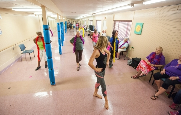 Sara Hoffman, in foreground, leads a burlesque dance at Derfelt Senior Center in Lorenzi Park in Las Vegas on Thursday, Oct. 1, 2015. It was the first time the class was being held. Chase Stevens/ ...