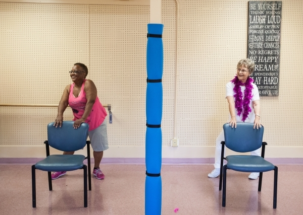Seventy-four-year-old Sally Phillips, left, and Nancy Nelson, 79, participate in a burlesque dance class at Derfelt Senior Center in Lorenzi Park in Las Vegas on Thursday, Oct. 1, 2015. It was the ...