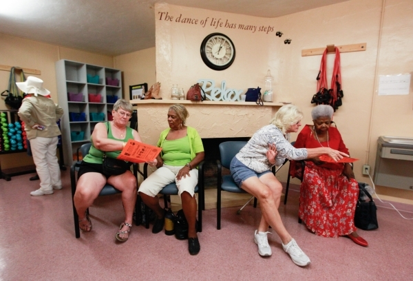 People look through events calendars before a burlesque dance class at Derfelt Senior Center in Lorenzi Park in Las Vegas on Thursday, Oct. 1, 2015. It was the first time the class was being held. ...