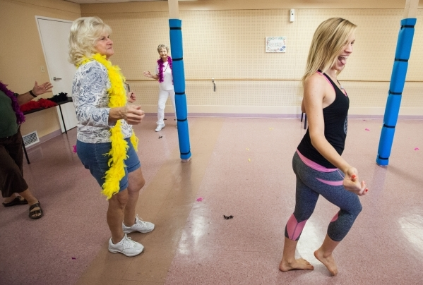 Sara Hoffman, right, leads a burlesque dance class as Mary Fazzalaro, left, participates at Derfelt Senior Center in Lorenzi Park in Las Vegas on Thursday, Oct. 1, 2015. It was the first time the  ...