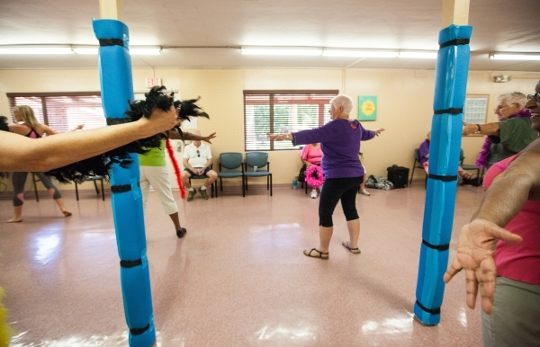 People participate in a burlesque dance class at Derfelt Senior Center in Lorenzi Park in Las Vegas on Thursday, Oct. 1, 2015. It was the first time the class was being held. Chase Stevens/Las Veg ...