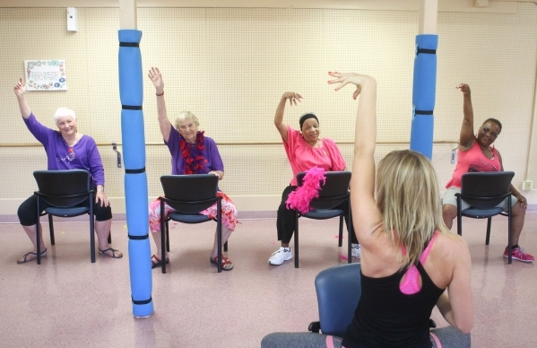 Sara Hoffman, second from right, leads a burlesque dance class as, from left, Judy England, 73, Paulisca Buckholz, 84, andDee Gordon, 81 and Sally Phillips, 74, participate at Derfelt Senior Cente ...