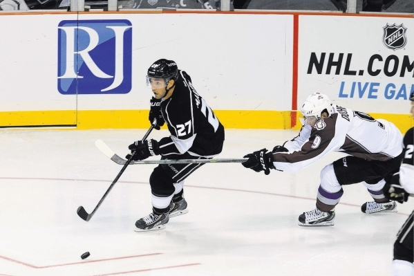 Los Angeles Kings defenseman Alec Martinez is chased by Colorado Avalanche center Matt Duchene during their pre-season game Saturday, Oct. 4, 2014 at the MGM Grand Garden Arena. (Sam Morris/Las Ve ...