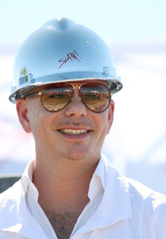 Rapper Pitbull attends a groundbreaking ceremony for Sports Leadership and Management (SLAM!) charter middle and high school Friday, Oct. 2, 2015, near the Russell Road Recreation Complex in Hende ...
