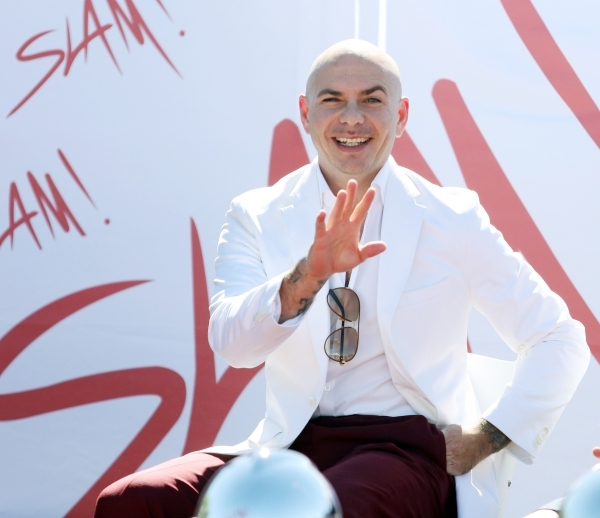 Rapper Pitbull waves during a groundbreaking ceremony for Sports Leadership and Management (SLAM!) charter middle and high school Friday, Oct. 2, 2015, near the Russell Road Recreation Complex in  ...