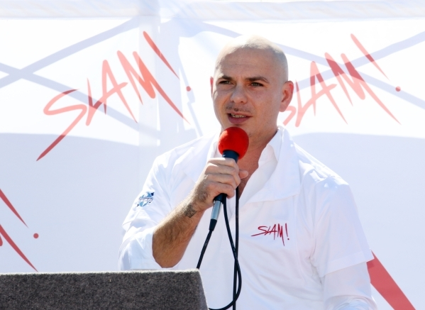 Rapper Pitbull speaks during a groundbreaking ceremony for Sports Leadership and Management (SLAM!) charter middle and high school Friday, Oct. 2, 2015, near the Russell Road Recreation Complex in ...