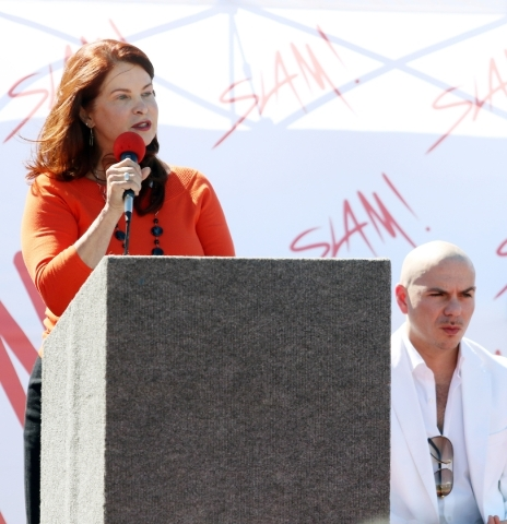 Henderson Mayor Pro Tem Debra March, left, speaks near rapper Pitbull during a groundbreaking ceremony for Sports Leadership and Management (SLAM!) charter middle and high school Friday, Oct. 2, 2 ...